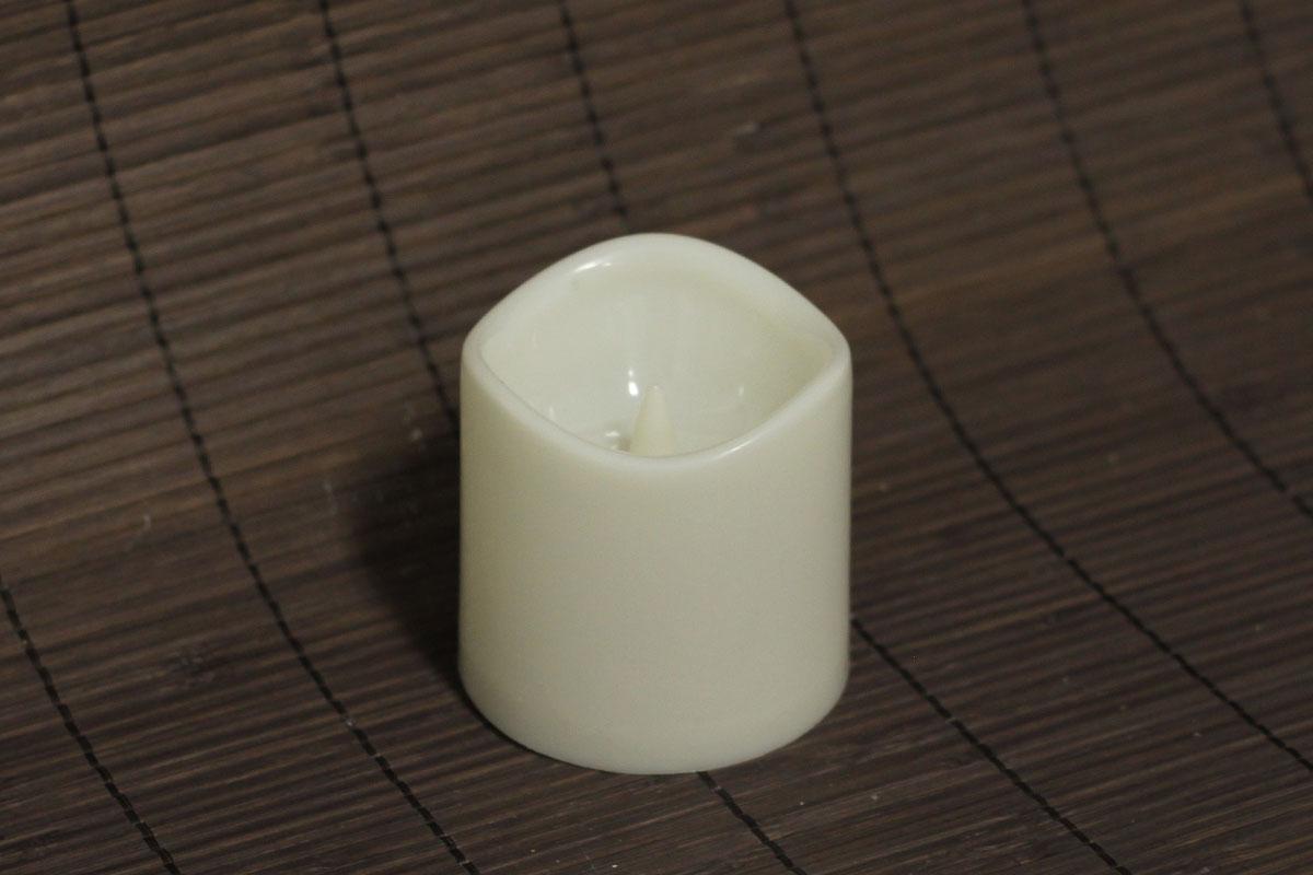 Autronic - Svícen z plastu ve tvaru svíčky, s LED světlem a časovačem - LUC073