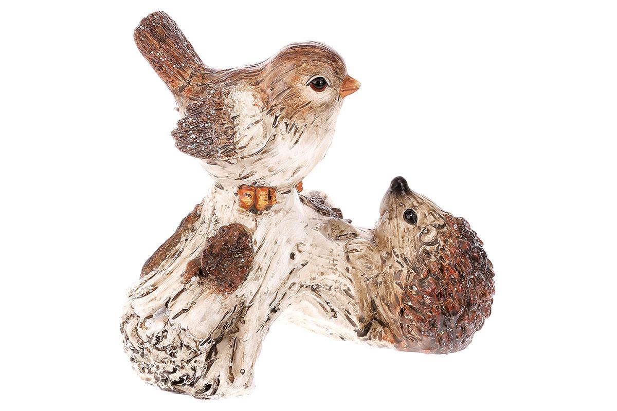 Ptáček a ježek na větvi. Polyresin.