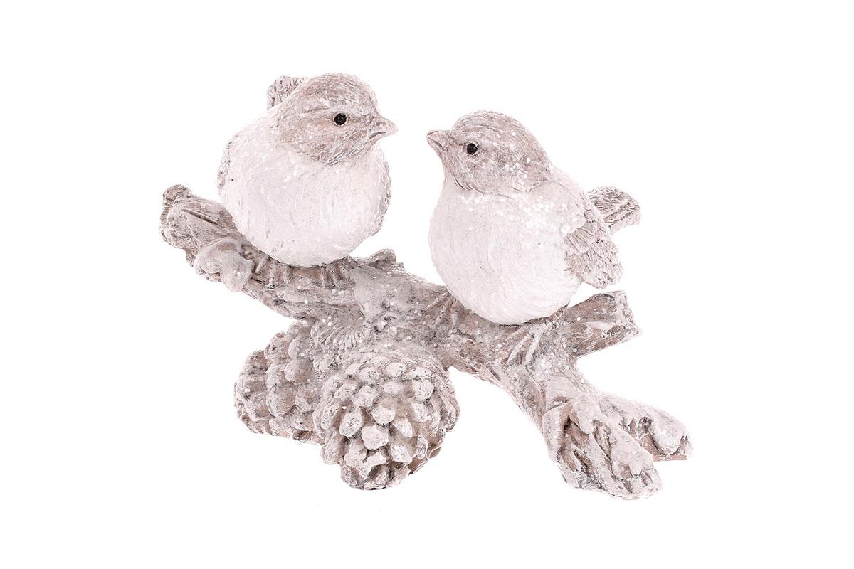 Ptáčci na větvi, sněhově bílá barva.