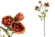 Růže, barva tmavě oranžová. Květina umělá.